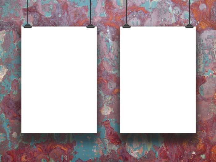 Close-Up Of Blank Paper Hanging Against Wall