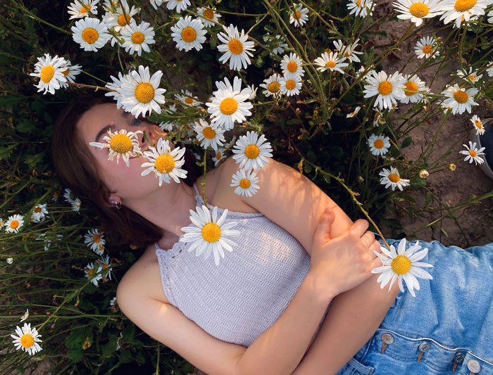 High angle view of woman amidst flowering plants