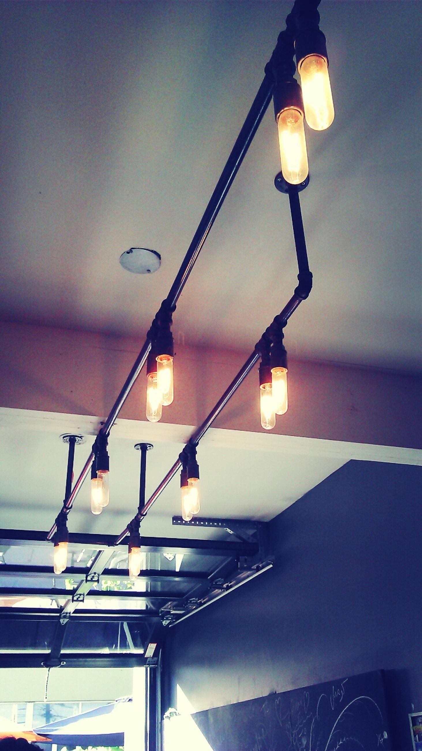 illuminated, lighting equipment, indoors, electricity, electric lamp, hanging, electric light, low angle view, light bulb, lamp, glowing, ceiling, lit, light - natural phenomenon, decoration, lantern, night, street light, home interior, no people
