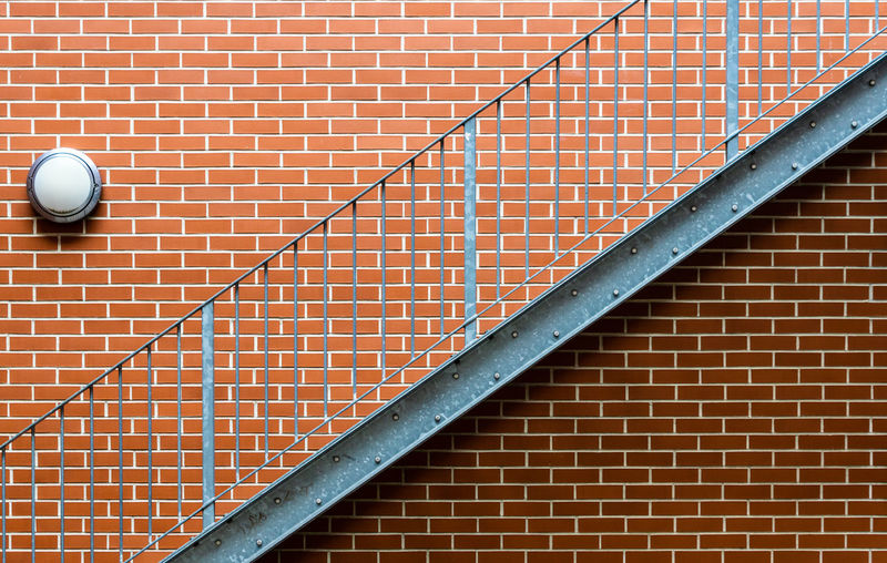 Steps on brick wall