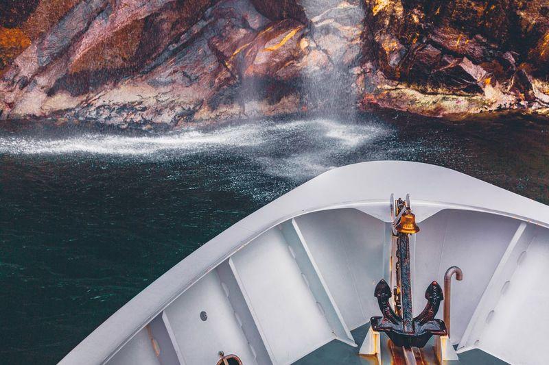 Cruising Milford Sound Nautical Vessel Transportation Outdoors Water New Zealand Travel Adventure Waterfall Mountain Peak Cruise Ship Vacations