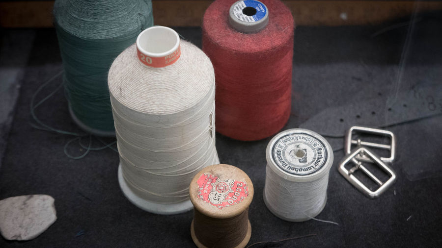 Art And Craft Thread High Angle View Creativity Textile Spool Still Life Focus On Foreground Table Close-up Red Button Tartan Check Tartan Scotland Sewing Sewing Needle Sewing Stuff