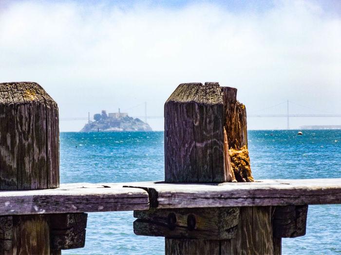 Wooden fence against remote alcatraz island