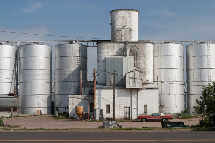 Silos in Sidney, Nebraska America Americana Car Day Farming Industry Land Vehicle Nebraska Outdoors Roadside Roadside America Rural Rural Scene Sidney Silo Storage Compartment Tall United States USA