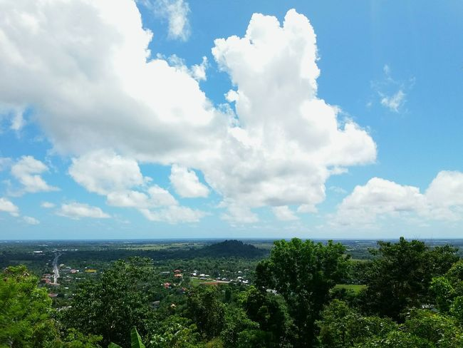 The blue sky painted with white fluffy clouds. Cloud - Sky Day Sky Growth Outdoors No People Tranquility Nature Sea Scenics Water Beauty In Nature Horizon Over Water City Cityscape Aklan, Philippines Aklan The Great Outdoors - 2017 EyeEm Awards EyeEmNewHere 100 Days Of Summer Sommergefühle EyeEm Selects Breathing Space