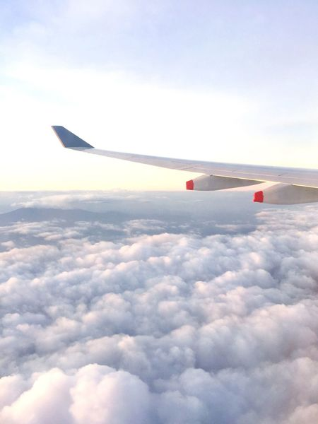 Cloud - Sky Sky Airplane Flying Transportation Nature Day No People Outdoors Cloudscape Aircraft Wing Beauty In Nature Air Vehicle Airplane Wing Travel Sea Of ​​clouds Up Above Up Above The World So High
