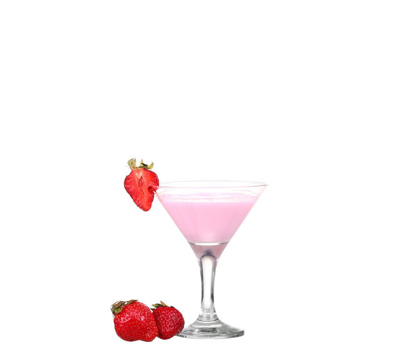 Red berries on glass against white background