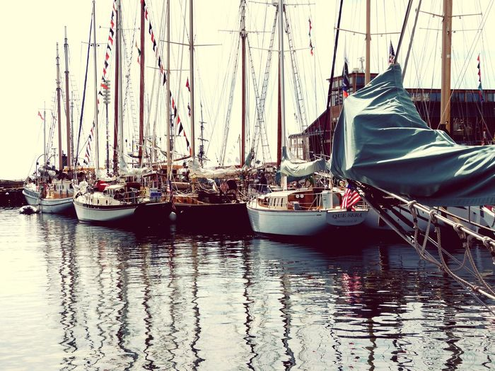 Nautical Vessel Transportation Waterfront Boat Mode Of Transport Water Sailboat Mast Reflection Calm Port Townsend Wooden Boat Fest Old Boats In A Row Transportation Sailing Boat Cloud Day Tranquility Harbor Tranquil Scene Journey Multi Colored No People EyeEm Best Shots