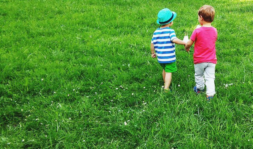 Boy playing on grass