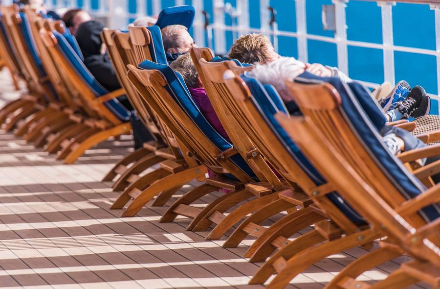 Sea Travel and Cruise Ship Relax. People Relaxing on Deckchairs During Transatlantic Cruise. Cruise Ship Deckchairs Traveling Arrangement Chair Close-up Day Enjoying Life Group Of Objects In A Row Indoors  Large Group Of Objects No People People Relaxation Sea Travel Seat Seniors Travelers Vacation