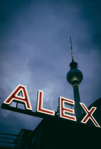 Alex Berlin Typography Architecture Communication Low Angle View Built Structure Building Exterior Tall - High Text Travel Destinations No People Outdoors Sky Television Tower Illuminated City The Traveler - 2018 EyeEm Awards