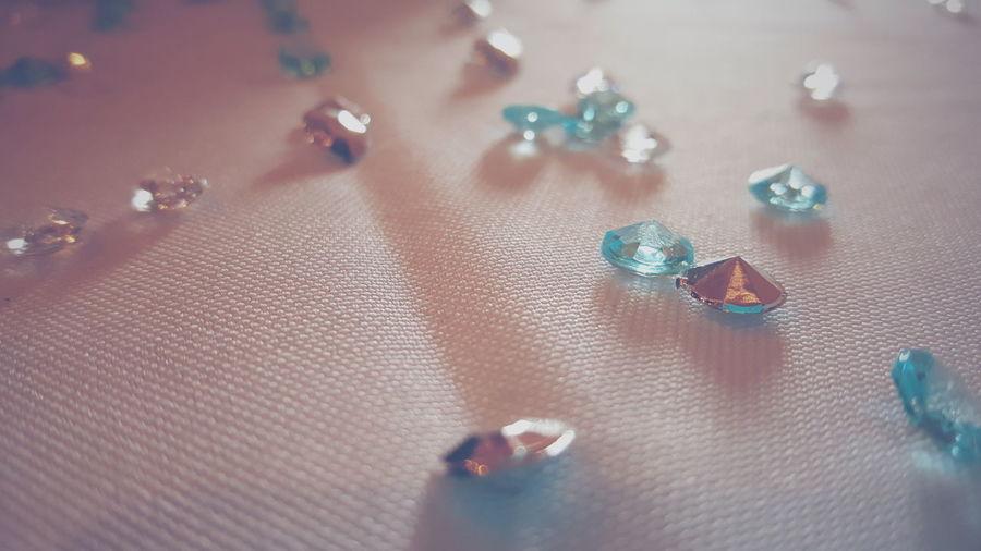 Close-Up Of Diamonds On Fabric
