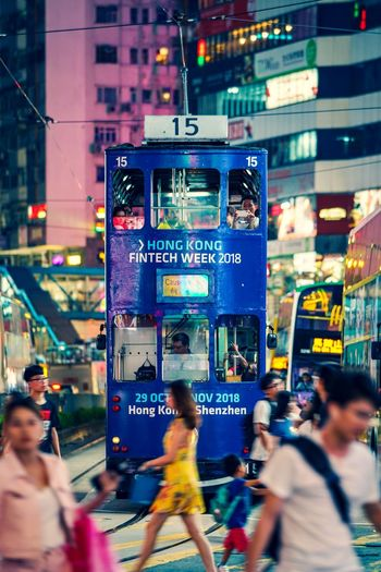 crossing Discoverhongkong Hktramways Street Photography Reframinghk cityscapes City Architecture Building Exterior Text Built Structure Communication Crowd Street Illuminated Real People Outdoors Transportation Western Script City Street Group Of People Sign City Life People Night