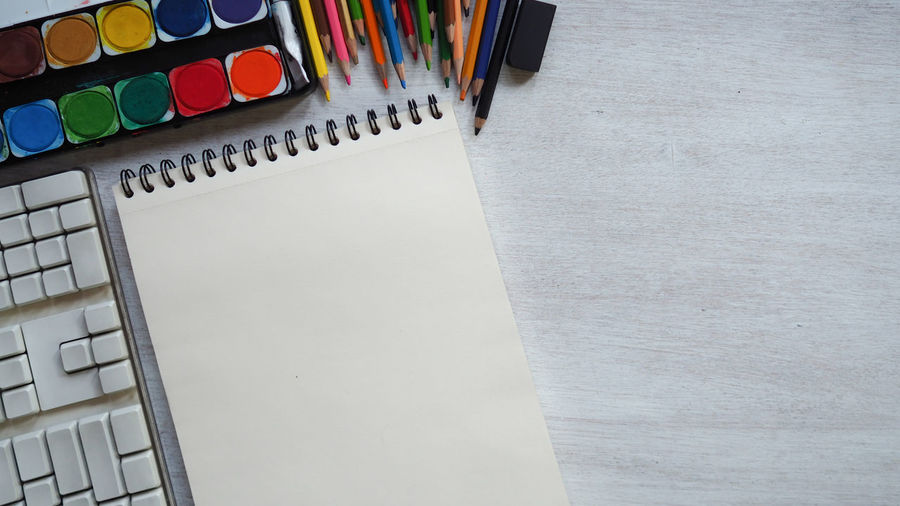 Place of work, blank white color paper page and colorful pencil on vintage wooden desk, creative designer artist concepts for business and education background Architecture Still Life Drawing Table Office Order Paper Artist Art And Craft Supplies Book Sketchbook Pen Blank Indoors  Workplace Education Close-up No People Watercolor Painting Publication In A Row Copy Space High Angle View White Color Large Group Of Objects Multi Colored Book Pages Art And Craft Equipment Indoors  Writing Instrument Pencil Note Pad