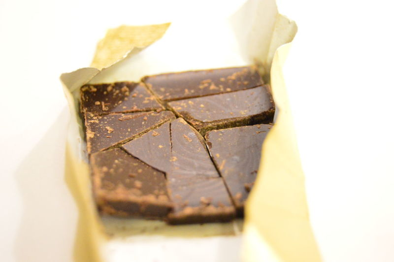 Close-up of chocolate in wrapping paper on white background