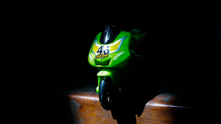 Close-up of toy over black background