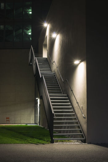 Illuminated staircase at night