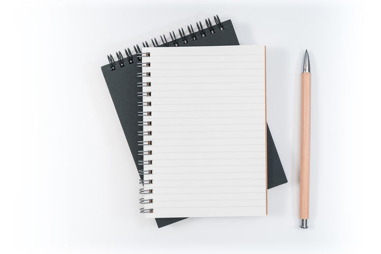Spiral Notebook Book No People Indoors  Publication Still Life Note Pad White Background Pen Paper Studio Shot Copy Space High Angle View Spiral Education Open White Color Writing Instrument Page Blank
