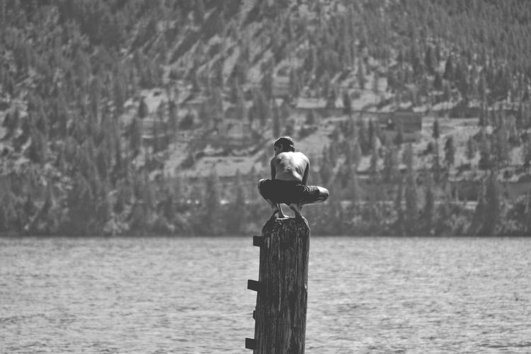 Balancing Act Life Squatting Swimming B&w Balance Balancing Beauty In Nature Blackandwhite Boy Childhood Cormorant  Day Excitement Focus On Foreground Lake Lakelife Lifestyles Nature Outdoor Pursuit Outdoors Perching Water Waterfront Wooden Post The Week On EyeEm Black And White Friday An Eye For Travel Summer Exploratorium The Great Outdoors - 2018 EyeEm Awards Summer Sports Be Brave