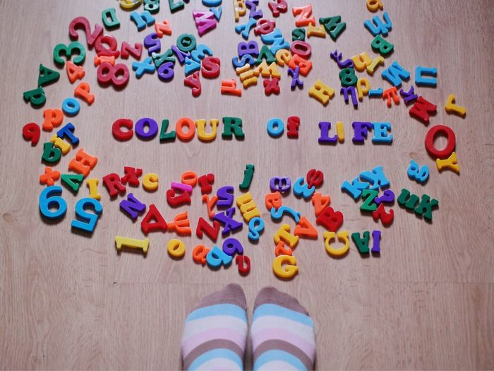 Close-up of colorful letters scattered on floor