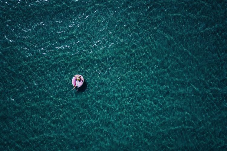 High angle view of woman relaxing in boat on sea