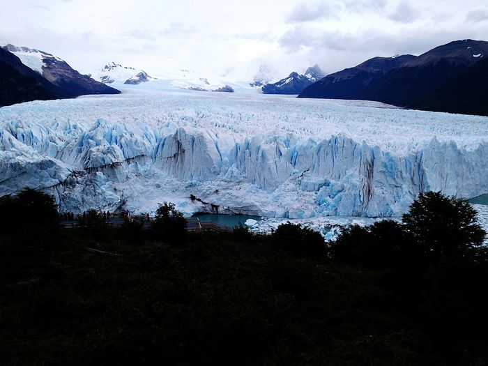 Idyllic shot of perito moreno glacier against cloudy sky