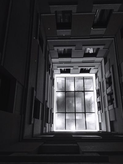 Low angle view f skylight on top of building staircase