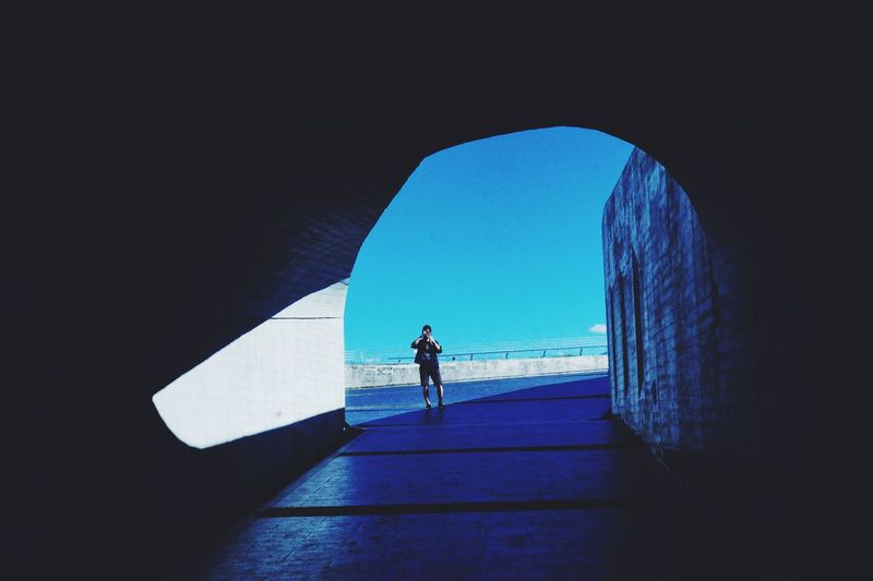 Man On Street Seen Through Tunnel