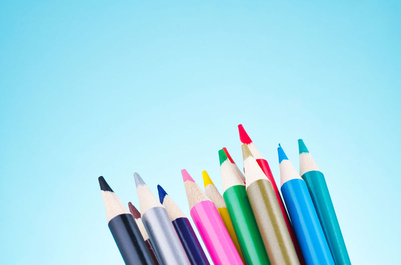 colourful pencils over beautiful reverberation gradient background Multi Colored Writing Instrument Variation Choice Large Group Of Objects Copy Space Studio Shot Art And Craft Still Life Indoors  Pencil Colored Pencil No People Close-up Collection Craft Blue Art And Craft Equipment Creativity Colored Background Blue Background