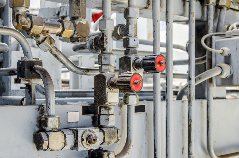 Close-up of pipe connection in factory