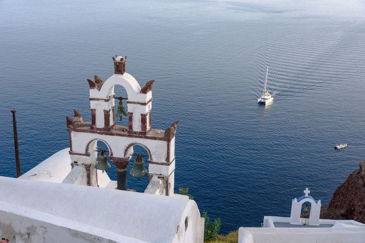 High angle view of statue by sea against sky