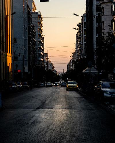 Traffic on city street during sunset