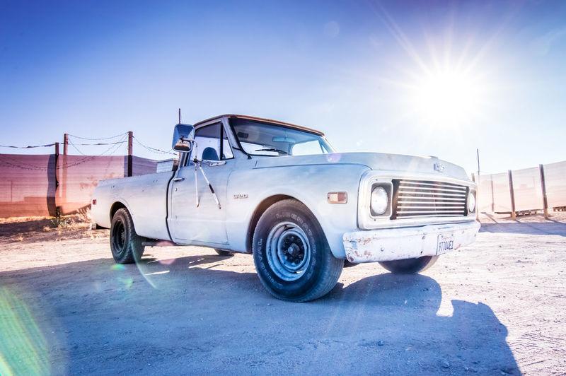 Vintage car against blue sky on sunny day