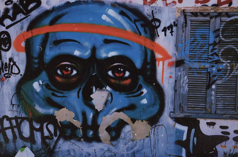 Close-up portrait of graffiti on wall