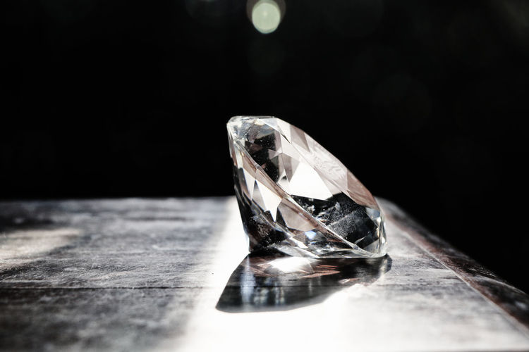 Close-up of diamond on table