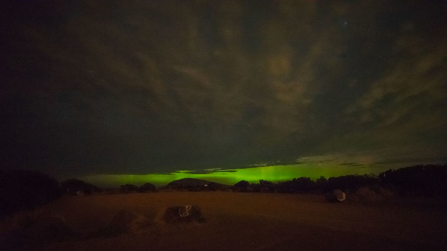 Aurora Australis and overcast clouds Aurora Australis Beauty In Nature Cloud - Sky Clouds And Sky Dusk Environment Field Land Landscape Nature Night No People Non-urban Scene Outdoors Overcast Scenics - Nature Sky Southern Hemisphere Southern Lights Windy