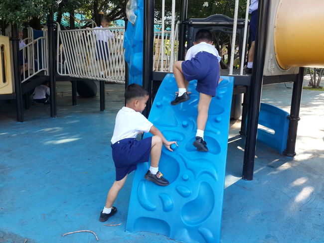 Day Playground Volunteer Full Length City Togetherness Headwear Men Women Security Guard Walkie-talkie Barbed Wire Settlement Community Outreach Donation Box Charitable Donation Office Building Outdoor Play Equipment Slide - Play Equipment Jungle Gym Assisted Living