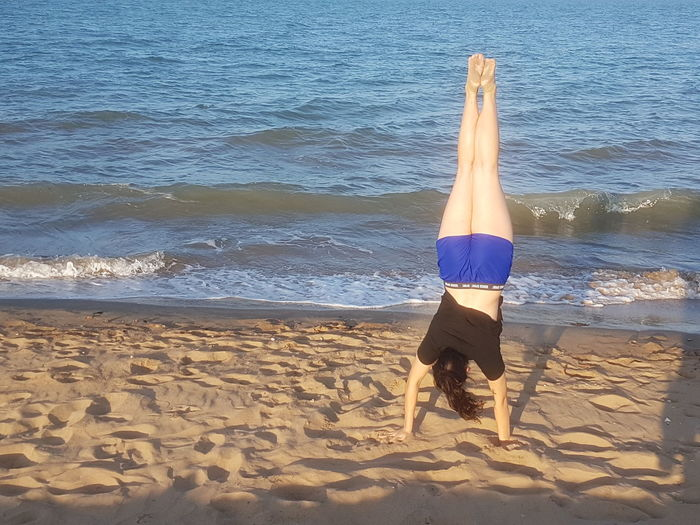People And Places Beach Exercise Vacations Outdoors Nature Wave Person Beauty In Nature Coastline Tranquil Scene Sea Water Shore Sand Beach Hand Stand Young Girl