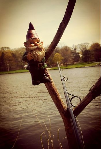 My fishin gnome!! Water Tree Nature Outdoors Day Check This Out Gnomes Of EyeEm Picturejunkie Taking Photos Beauty In Nature Iowariver Nature Fishing Life Beautiful Day Fishing Fishing Pole Fishing Line