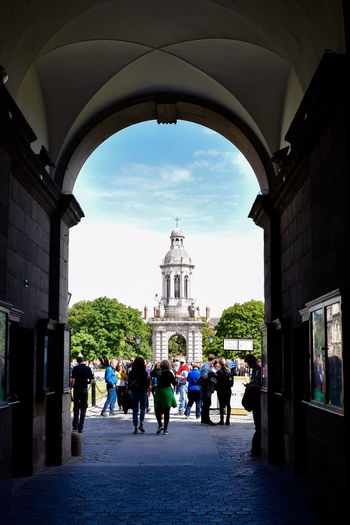 Trinity College entrance in Dublin Architecture Dublin Ireland Sunny Trinity Adult Arch Arched Architecture Building Building Exterior Built Structure City Crowd Day Lifestyles Nature Outdoors Real People Sky The Way Forward Travel Destinations