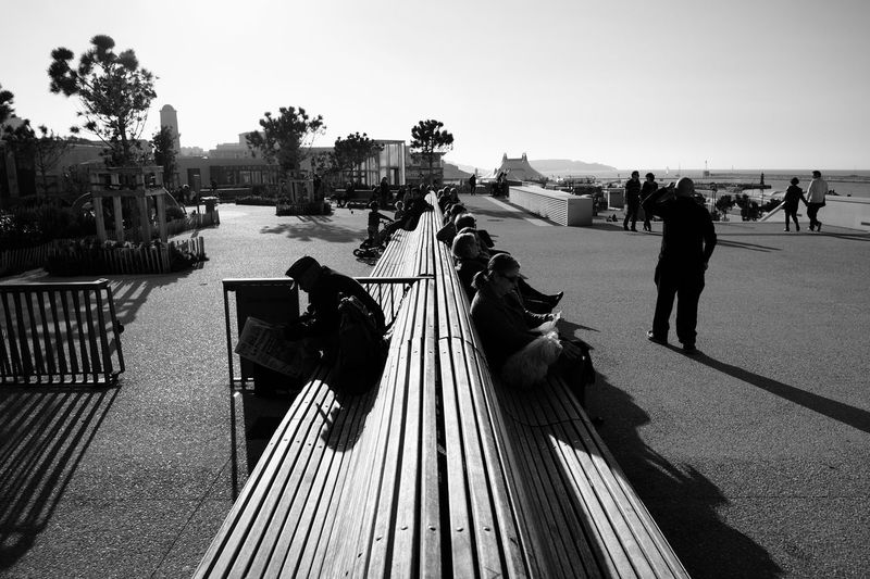 People sitting on park bench at mucem
