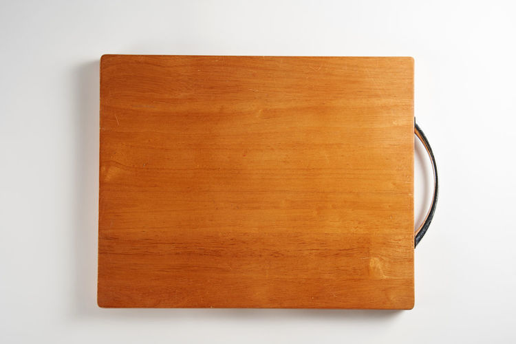 High angle view of book on table against white background