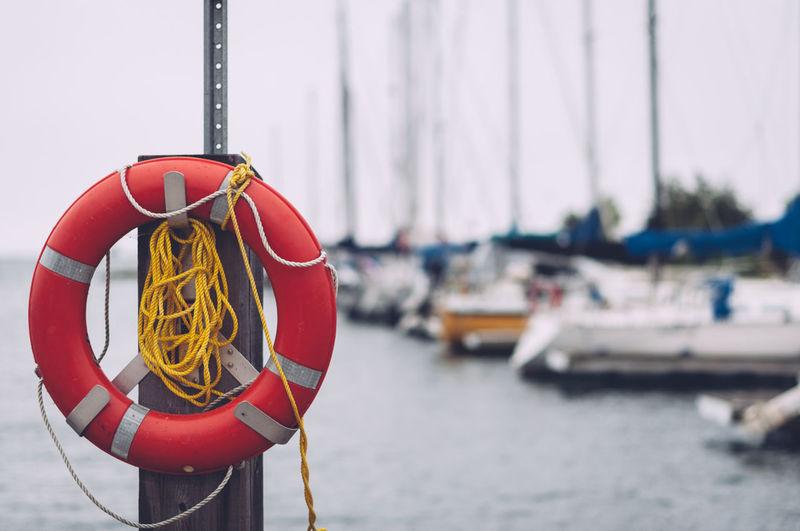 Life belt on pole at harbor