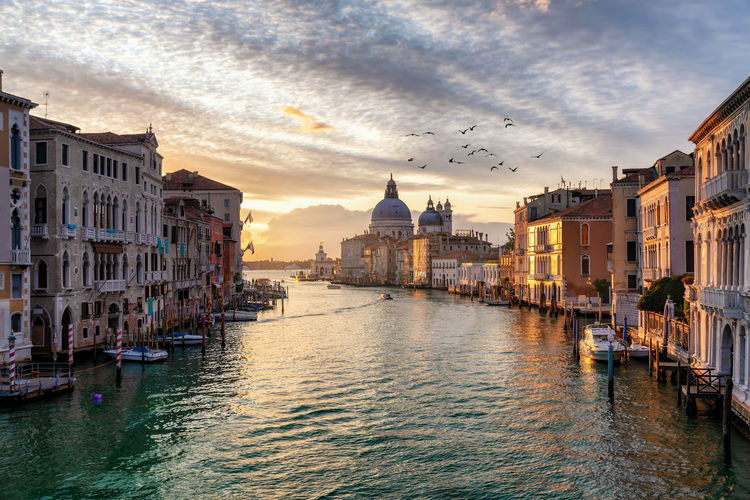 View over the Canale Grande in Venice, Italy, during sunrise Built Structure Building Exterior Architecture Water Cloud - Sky Sky Canal City Building Travel Destinations Waterfront Travel Residential District Mode Of Transportation Gondola - Traditional Boat Outdoors Venice Italy Veneto Canale Grande Sunrise Morning Sun No People Idyllic Scenery Tourist Attraction  Tourism Travel