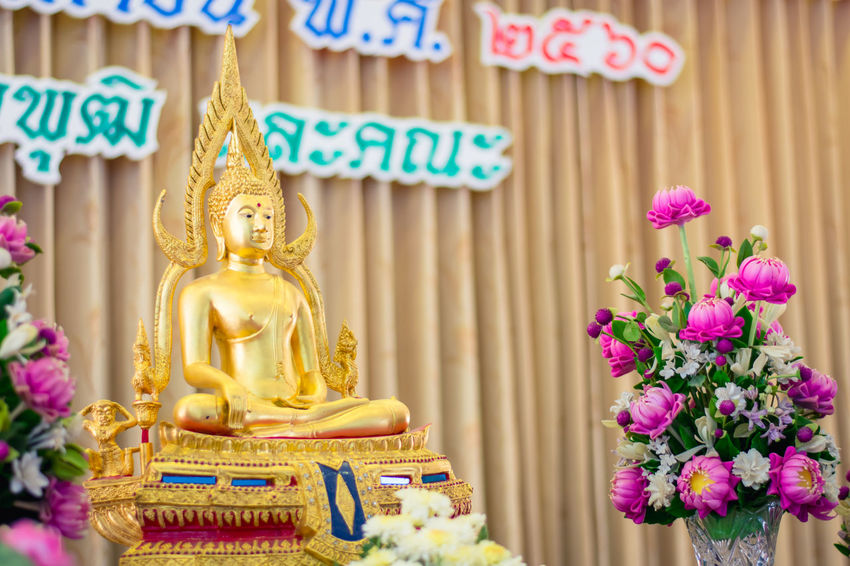 A close up of a golden buddha statue. Buddha Colors Gold Golden Light Statue Thai Buddha Statue Buddhism Buddhist Temple Close-up Colorful Day Flower Gold Colored Interior No People Outdoors Religion Religion And Beliefs Sculpture Spirituality Statue Temple Traditional