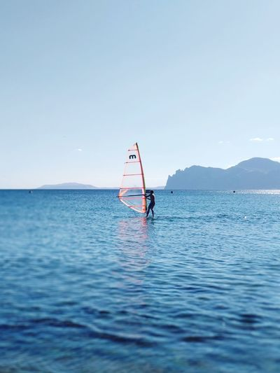 Mountains Meganom Water Sea Men Full Length Clear Sky Blue Horizon Sky Horizon Over Water Windsurfing Surfing Seascape Paddleboarding Surfboard Coast Surf Calm Floating On Water Surfer Aquatic Sport Water Sport Tide