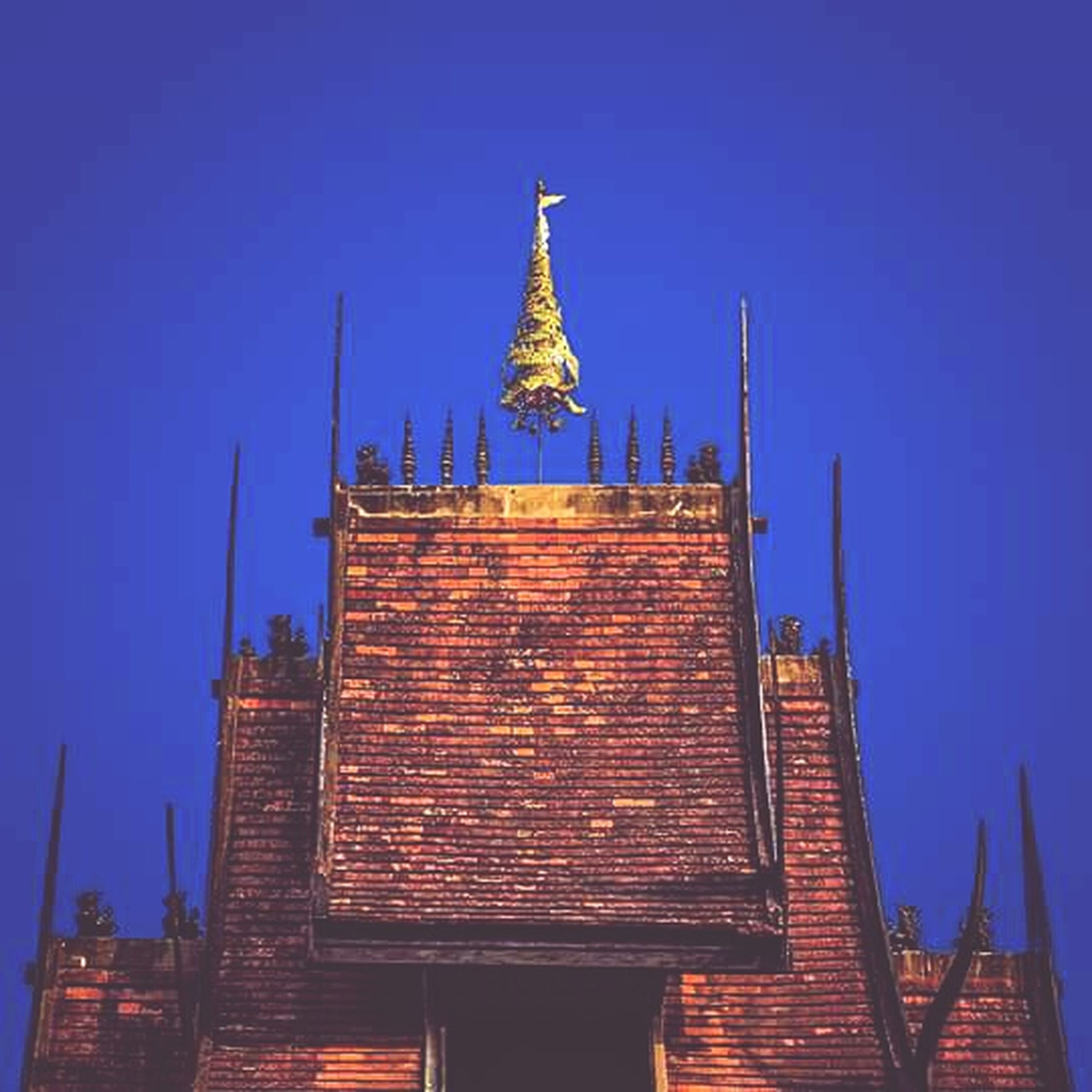 architecture, building exterior, built structure, low angle view, clear sky, blue, place of worship, religion, copy space, spirituality, high section, outdoors, tower, church, sky, roof, no people, day, building