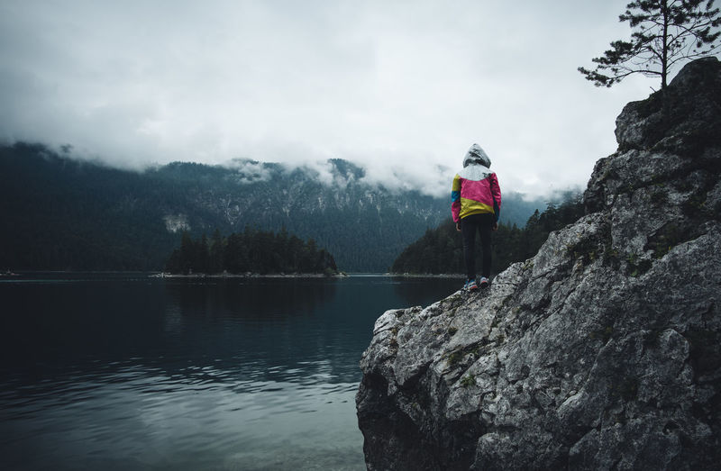 Eibsee Zugspitze Alpen See Alpensee Lake Reflection One Person Sky Mountain Rock Outdoors Nature Lifestyles Real People Rear View Jacket Water Fog Foggy Mood Beauty In Nature Human Body Part Standing Traveling