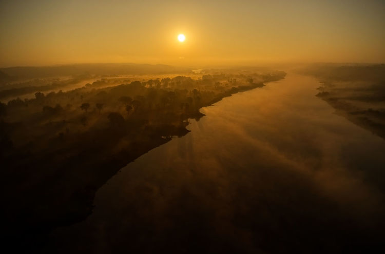 Aerial View Beauty In Nature Environment Fog Idyllic Landscape Nature No People Non-urban Scene Orange Color Outdoors Reflection Scenics - Nature Sky Sun Sunset Tranquil Scene Tranquility Water