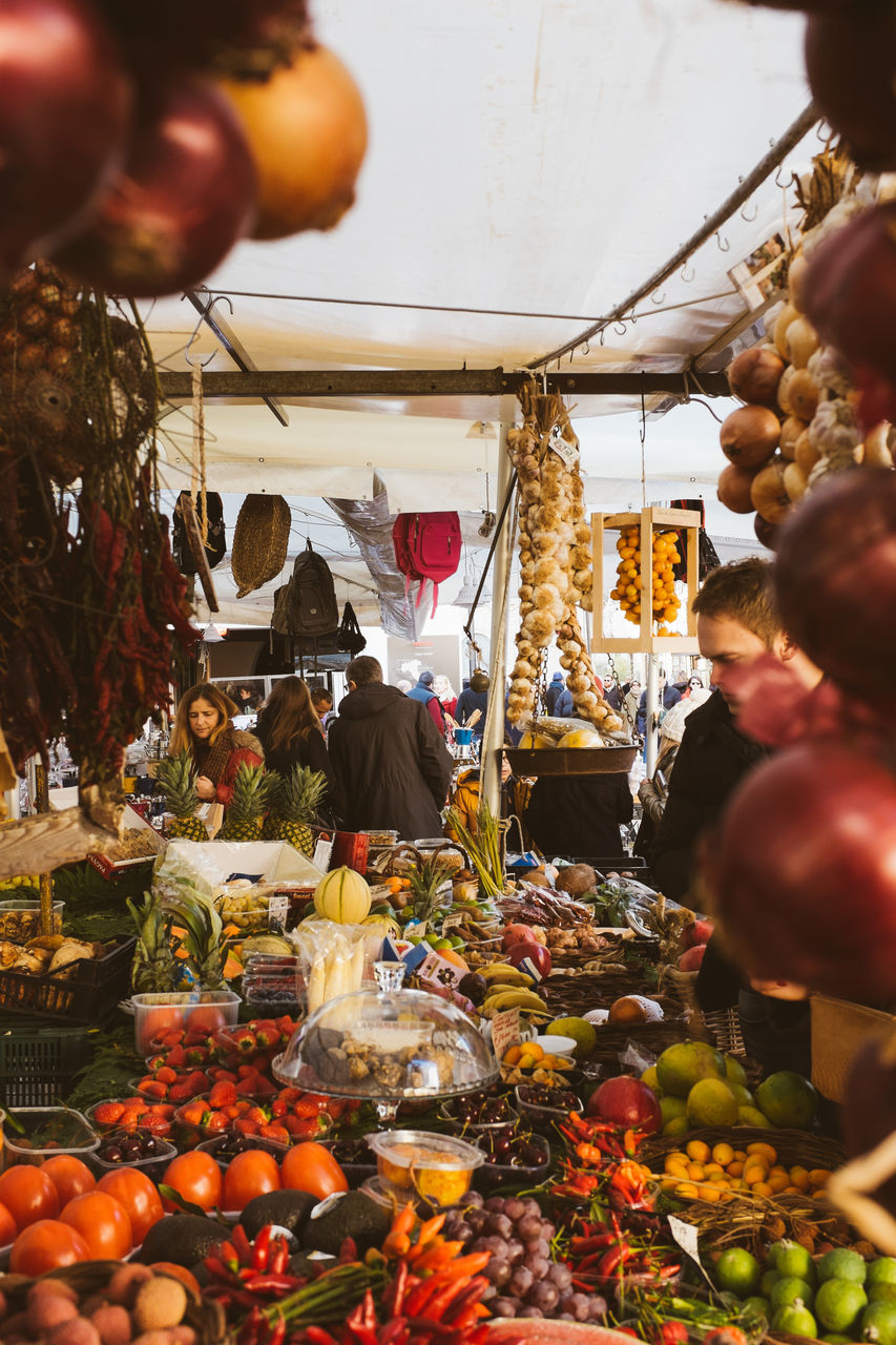 retail, market stall, market, for sale, food, variation, real people, food and drink, vegetable, choice, men, buying, fruit, small business, hanging, healthy eating, abundance, customer, freshness, large group of objects, women, day, farmer market, consumerism, outdoors, lifestyles